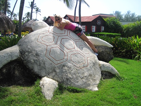 Trish laying on a turtle